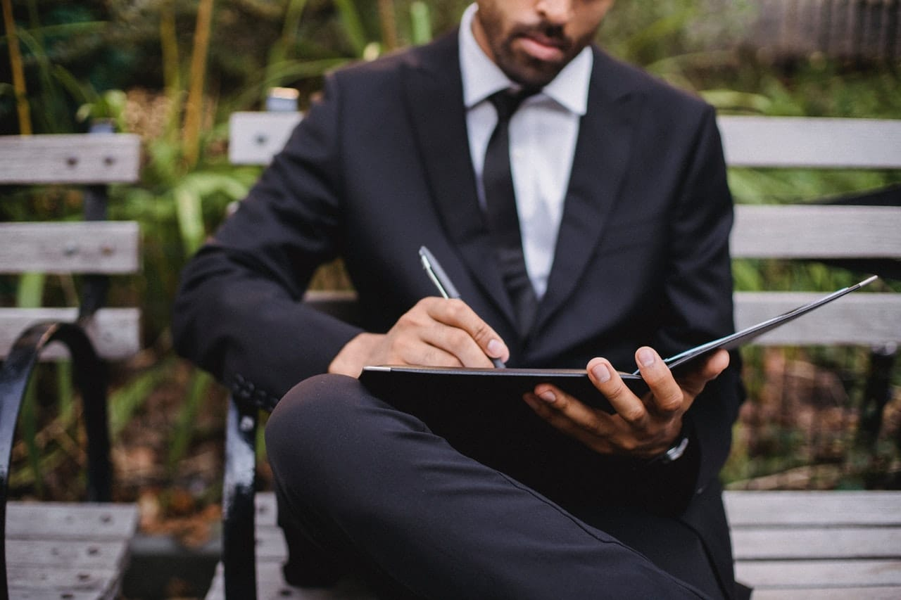 man in a suit writing