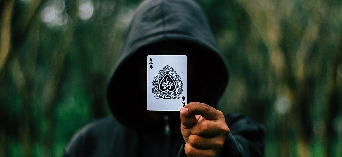 person holding an ace of spades