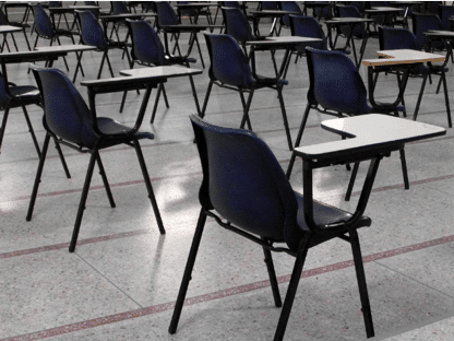 Chairs and desk in an IELTS test center.