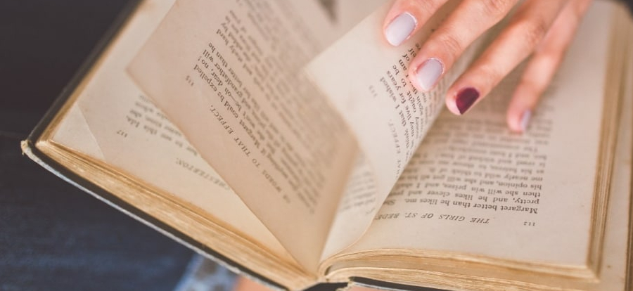 someone turns the pages of an old book
