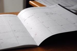 Calendar book open.