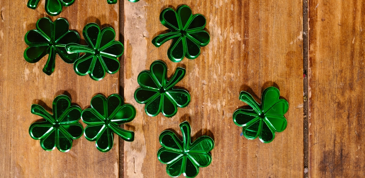 five leaf clovers on a table
