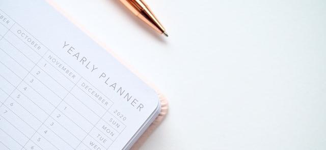 calendar with a pen on it