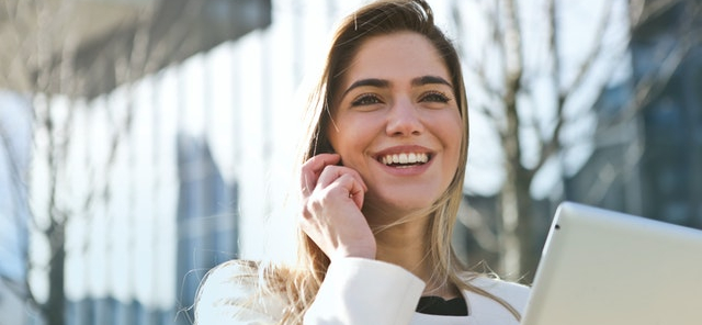 woman talking and smiling on the phone