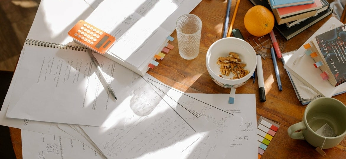papers documents and food on a table