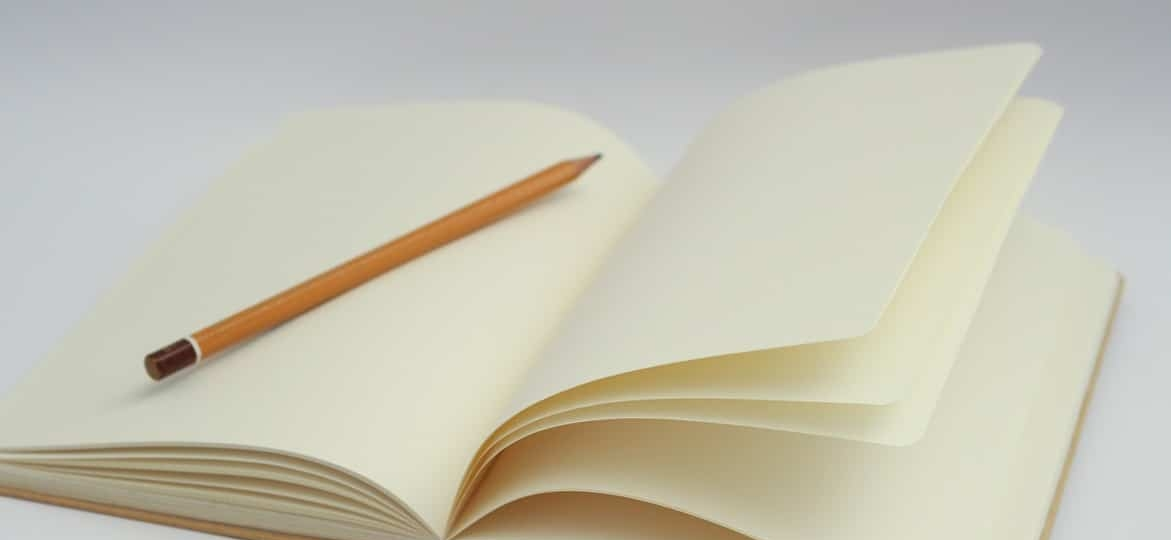 white-notebook-and-pencil